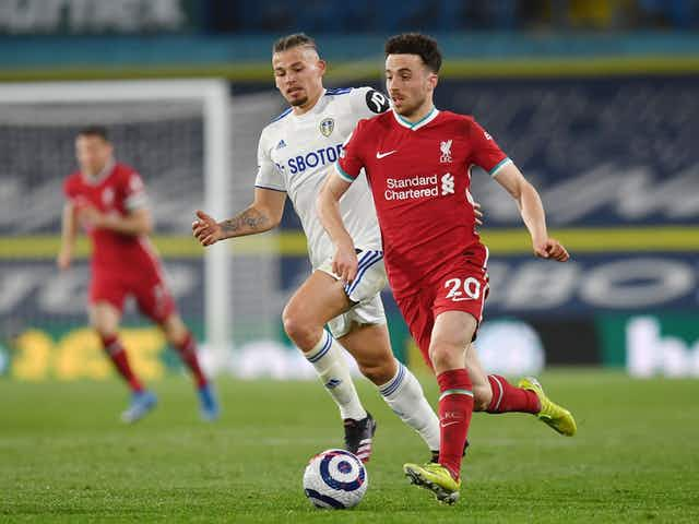 Diogo Jota's absence from training pictures suggests potential injury concern for Liverpool