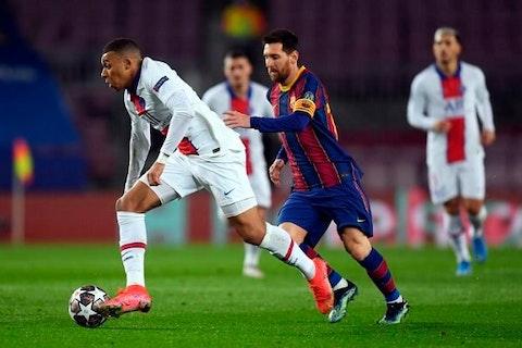 Imagem do artigo: https://image-service.onefootball.com/resize?fit=max&h=713&image=https%3A%2F%2Fmaisqueumjogo.com.br%2Fwp-content%2Fuploads%2F2021%2F02%2FMbapp%C3%A9-e-Messi-Champions-League.jpg&q=25&w=1080