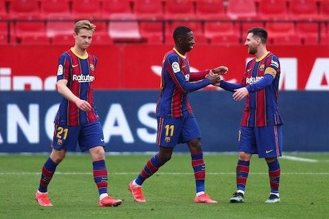 Imagem do artigo: https://image-service.onefootball.com/crop/face?h=810&image=https%3A%2F%2Fwp-images.onefootball.com%2Fwp-content%2Fuploads%2Fsites%2F13%2F2021%2F02%2FSevilla-FC-v-FC-Barcelona-La-Liga-Santander-1614445862-1000x666.jpg&q=25&w=1080