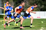 Samp back in training in two groups