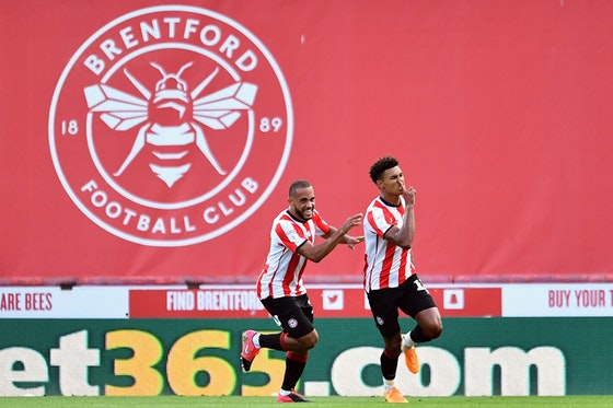 Article image: https://image-service.onefootball.com/crop/face?h=810&image=https%3A%2F%2Fwww.thetotallyfootballshow.com%2Fapp%2Fuploads%2F2020%2F07%2FBrentford-Watkins-Mbeumo-scaled.jpg&q=25&w=1080